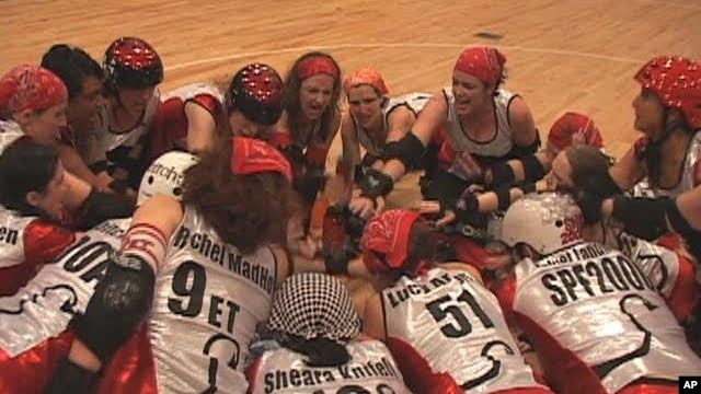 The D.C. Demon Cats, an all-women's roller derby team, huddle before their opening match of the season