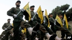 FILE - Hezbollah fighters parade in a southern suburb of Beirut, Lebanon, Nov. 12, 2010.