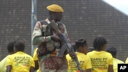 FILE: A soldier stands guard while waiting for Zimbabwean President Robert Mugabe to arrive for a crucial Zanu pf Poltiburo meeting in Harare, Wednesday Feb, 10, 2016. Mugabe addressed thousand of party supporters and chaired a bitterly divided Zanu PF Politiburo amid heightened tensions over issues to do with factionalism and succession in the party.(AP Photo/Tsvangirayi Mukwazhi)