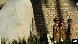FILE - Cuba's President Raul Castro stands before the tomb of his brother, Cuba's late leader Fidel Castro, on the one year anniversary that Fidel was buried, in Santiago, Cuba, Dec. 4, 2017.