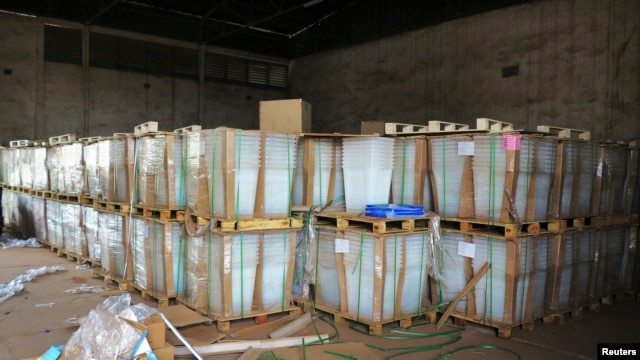 Electoral materials are stacked in a customs office after shipment from France in Bamako, Mali, June 18 2013.