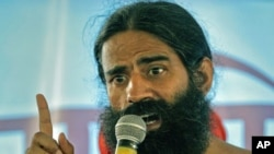 India's yoga guru Swami Ramdev addresses supporters during his fast against corruption in the northern Indian town of Haridwar, June 8, 2011