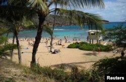 FILE - Sunbathers and snorkelers enjoying a beach day at Hanauma Bay, on the east side of Oahu, Hawaii.