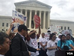 Demonstrators gather outside the Supreme Court after a tied vote in the court thwarted President Barack Obama's plan to defer the deportation of millions of undocumented immigrants.