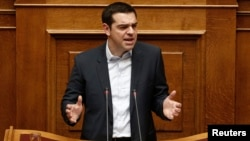 Greek Prime Minister Alexis Tsipras delivers his first major speech in parliament in Athens, Feb. 8, 2015.