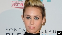 Miley Cyrus arrives at the iHeartRadio Ultimate Pool Party at the Fontainebleau Hotel on June 29, 2013 in Miami.