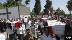 Suriye resmi haber ajansı SANA tarafından dağıtılan polis cenazeleri