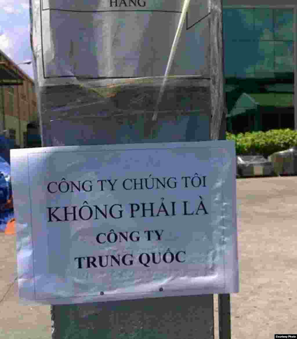 "A banner says ""Our company is not a Chinese company"" in Binh Duong."