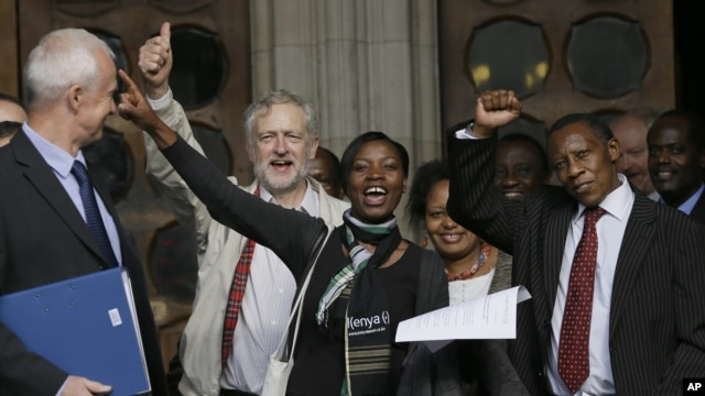 Supporters cheer outside the Royal Courts of Justice in London following a verdict in the Mau Mau torture compensation claim case, October 5, 2012.