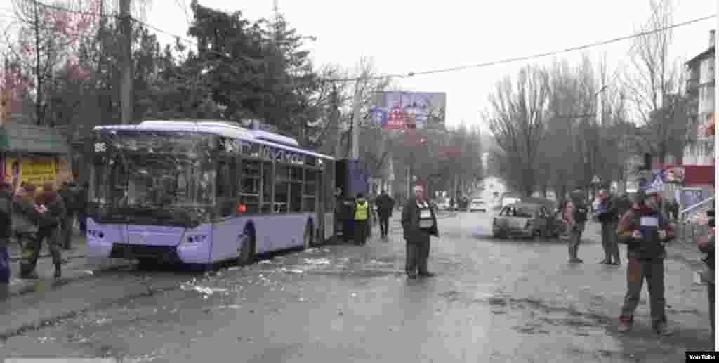 This still image captured from video footage shows a bus that was destroyed by shelling in Donetsk, Jan. 22, 2015.