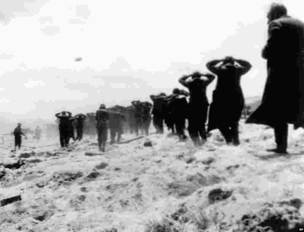 German prisoners of war are led away by Allied forces from Utah Beach, on June 6, 1944, during landing operations at the Normandy coast, France. (AP Photo)
