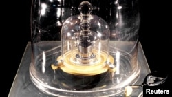 The International Prototype of the Kilogram (IPK) is pictured in Paris, France, in this undated photo obtained from social media, Nov. 12, 2018.