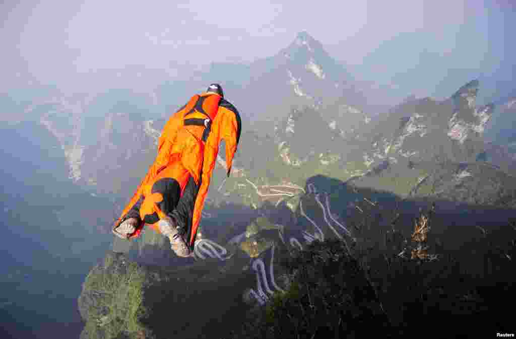 "Hungarian wingsuit flyer Victor Kovats jumps off a mountain at Tianmen Mountain National Park in Zhangjiajie, Hunan province, China, Oct. 8, 2013. Kovats died after failing to deploy his parachute prior to landing at the world championship staged in central China. His body was found after a team of more than 200 rescuers carried out searching by foot in the forests with no helicopter available on the spot. Initial analysis said the reason for the wingsuit flyer's plunge might relate to ""technical problem during the trial""."