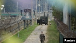 A South Korean soldier walks along a military fence near the demilitarized zone separating the two Koreas in Paju, South Korea, September 28, 2021.