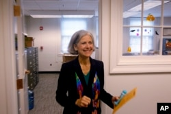 FILE - Green Party presidential candidate Jill Stein casts her ballot for U.S. president in Lexington, Mass., Oct. 26, 2012.