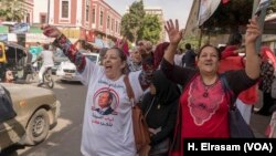Supporters of President Abdel Fattah al-Sissi try to drum up support in a last-minute bid to draw voters to the polls, March 27, 2018.