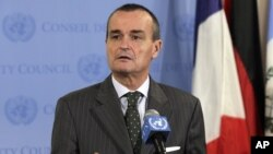 France's U.N. Ambassador Gerard Araud, the current Security Council president, answers reporters' questions at the United Nations after a closed meeting of the Security Council on Syria, August 16, 2012.