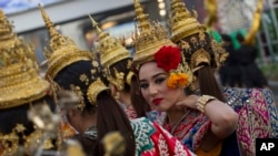 A Thai dancer performs during a parade held Wednesday, Jan. 14, 2015.