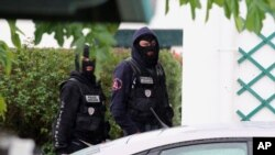 French police officers stand outside a villa during a search operation in Ascain, southwestern France, Nov. 5, 2016. French police arrested the leader of the debilitated Basque militant group ETA, Spain's Interior Ministry said Saturday.