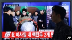 "FILE - A South Korean army soldier walks by a TV screen showing North Korean leader Kim Jong Un with superimposed letters that read: ""North Korea's nuclear warhead"" during a news program at Seoul Railway Station in Seoul, South Korea, March 9, 2016."