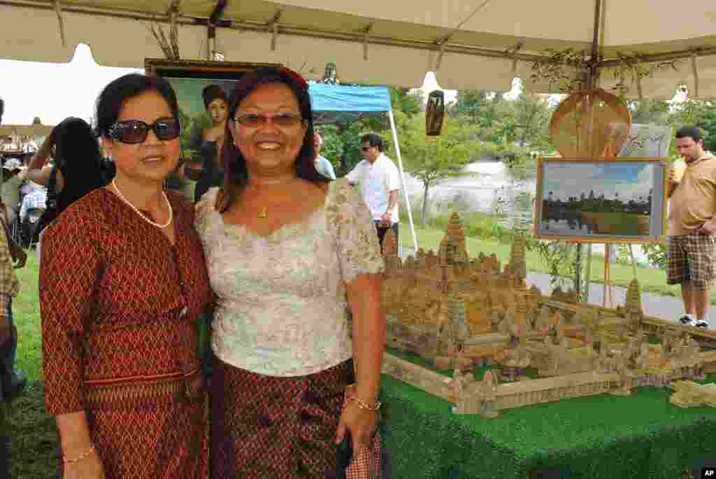 The lead organizers, Sophia Tep (left) and Somony Yann (right), proudly stand next to a five-thousand-dollar replica of Angkor Wat, which the Cambodian Community Day group commissioned from Cambodia.
