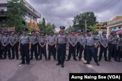 Police in Yangon's Bahan Township block protestors.