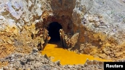 Yellow mine waste water is seen at the entrance to the Gold King Mine in San Juan County, Colorado, August 5, 2015.