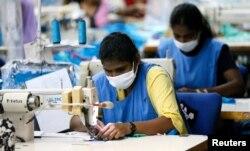 Garment workers sew skirts at a garments factory in Wattala, Sri Lanka, Nov. 2, 2017.