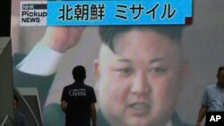 A TV news shows an image of North Korean leader Kim Jong Un while reporting North Korea's missile test which landed in the waters of Japan's economic zone in Tokyo, July 4, 2017. (AP Photo/Eugene Hoshiko)