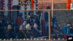 Japanese Prime Minister Shinzo Abe, center, watches Indian fighter planes flying past as the chief guest at the Indian Republic Day parade in New Delhi, India, Jan. 26, 2014.