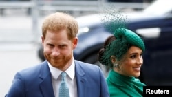 FILE PHOTO: Britain's Prince Harry and Meghan, Duchess of Sussex, arrive for the annual Commonwealth Service at Westminster Abbey in London, Britain March 9, 2020. REUTERS/Henry Nicholls/File Photo