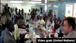 FILE- Reporters pack into the Erick de Mul conference room in Juba for a news conference by acting UNMISS head Toby Lanzer on Aug. 28, 2014.