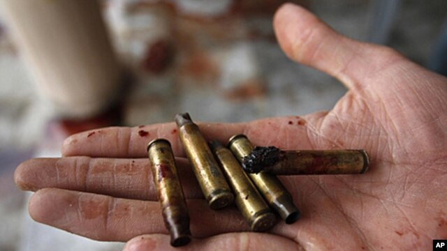 An Afghan man displays some of the used bullets at the scene where Sabar Lal Melma, a former Guantanamo detainee was allegedly killed in a NATO and Afghan forces raid in Jalalabad, Nangarhar province, east of Kabul, Afghanistan, September 3, 2011.