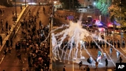 Pro-democracy demonstrators defied tear gas and appeals from Hong Kong's top leader to go home. The protest came after China's decision to limit political reforms.
