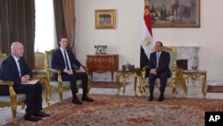 In this June 21, 2018, photo, provided by Egypt's state news agency, MENA, Egyptian President Abdel-Fattah el-Sissi, center, meets with President Donald Trump's son-in-law and senior adviser Jared Kushner, second left, and Middle East envoy Jason Greenbla