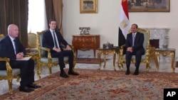 Egyptian President Abdel-Fattah el-Sissi, right, meets with President Donald Trump's son-in-law and senior adviser Jared Kushner, second left, and Middle East envoy Jason Greenblatt, left, June 21, 2018. Photo provided by Egypt's state news agency, MENA.
