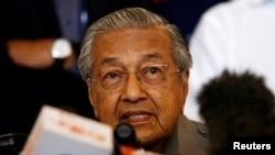លោក Mahathir Mohamad ថ្លែងនៅក្នុងសន្និសីទកាសែតមួយ បន្ទាប់ពីការបោះឆ្នោតសកលនៅក្នុងក្រុង Petaling Jaya ប្រទេសម៉ាឡេស៊ី កាលពីថ្ងៃទី១០ ខែឧសភា ឆ្នាំ២០១៨។