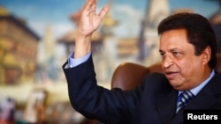 """FILE - Billionaire Binod Chaudhary, pictured in a Reuters interview in 2013, said the immense losses his country suffered in the April 25 earthquake have left Nepal facing """"perhaps one of the most challenging times ever"""" in its history."""
