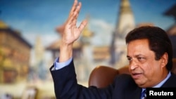 "FILE - Billionaire Binod Chaudhary, pictured in a Reuters interview in 2013, said the immense losses his country suffered in the April 25 earthquake have left Nepal facing ""perhaps one of the most challenging times ever"" in its history."