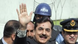 Pakistan's former Prime Minister Yusuf Raza Gilani waves after arriving at the Supreme Court in Islamabad, April 26, 2012.