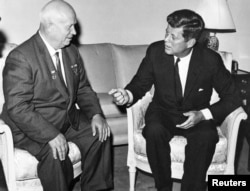 Presidents John F. Kennedy, Jr. and Nikita Khrushchev are seen in talks in this 1961 file photo