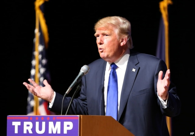 FILE - Republican presidential candidate Donald Trump speaks during a campaign town hall, at Pinkerton Academy in Derry, New Hampshire, Aug. 19, 2015.