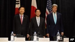 Minister of Foreign Affairs Yun Byung-se of South Korea, left, Minister of Foreign Affairs Fumio Kishida of Japan, and U.S. Secretary of State John Kerry stand for a photo during a meeting between the three leaders Sunday, Sept. 18, 2016, in New York .