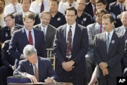 Marc Klaas is standing at right, as then President Bill Clinton signs a crime bill in 1994.