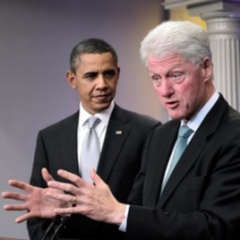 President Barack Obama looks on as former President Bill Clinton speaks in the briefing room of the White House in Washington, 10 Dec 2010