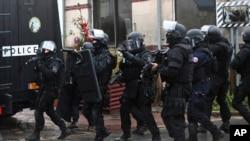 French police patrol in Longpont, north of Paris, France, Jan. 8, 2015.