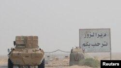 叙利亚路边的广告牌欢迎代尔祖尔居民回城。(2017年9月20日)