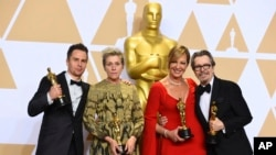"""Sam Rockwell, from left, winner of the award for best performance by an actor in a supporting role for """"Three Billboards Outside Ebbing, Missouri"""", Frances McDormand, winner of the award for best performance by an actress in a leading role for """"Three Billboards Outside Ebbing, Missouri"""", Allison Janney, winner of the award for best performance by an actress in a supporting role for """"I, Tonya"""", and Gary Oldman, winner of the award for best performance by an actor in a leading role for """"Darkest Hour"""", pose in the press room at the Oscars, March 4, 2018, at the Dolby Theatre in Los Angeles."""