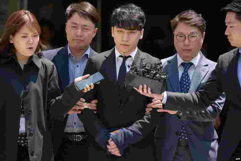 Seungri, a former member of the popular K-pop boy band Big Bang, real name Lee Seung-hyun, is taken into custody as he leaves the High Court in Seoul, South Korea. The 28-year-old is linked to a police investigation into Burning Sun, a nightclub where he was a public relations director, where staff are alleged to have filmed women with hidden cameras and used alcohol and drugs to sexually assault them.