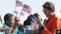 U.S. first lady Michelle Obama is greeted by children as she arrives in Gaborone, Botswana, Friday, June 24, 2011. (AP Photo/Charles Dharapak, Pool)